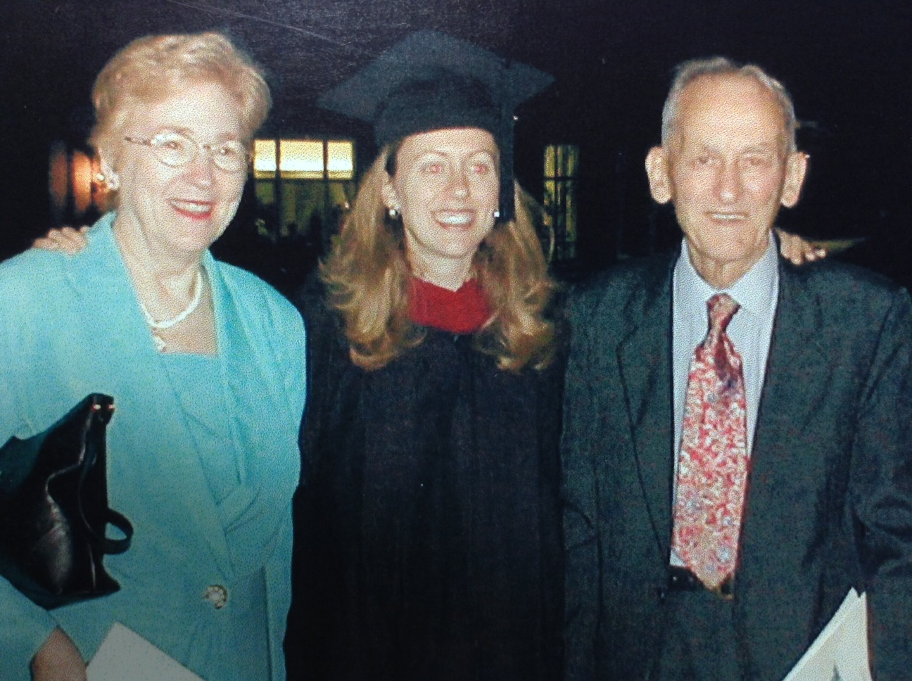 Dr Natalie Eastman, pictured here with her parents on the day she graduated with her PhD. Her father passed away the fall after seeing his daughter graduate.